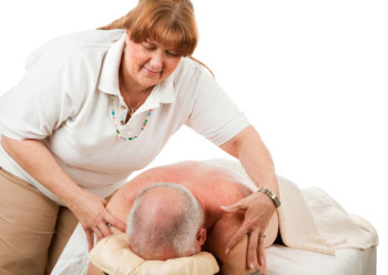 therapist massaging the old man